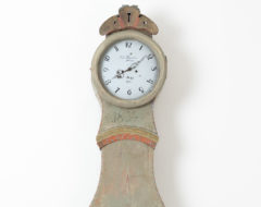 Green long case clock in the classical rococo shape. Scraped to the original first layer of paint of which the colour is a pale green.