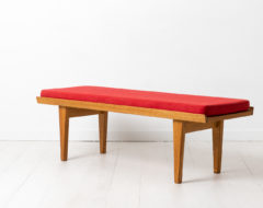 Vintage bench by Børge Mogensen for Karl Andersson & Söner. The bench is from the 1960s and has a frame in light oak and red upholstery