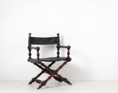 Swedish antique directors chair from the late 1800s. The chair is very unusual and has a frame in stained hardwood and upholstery in leather