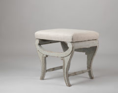 Light Swedish empire stool from around 1820. The paint is later and the stool has a renovated seat upholstered in linen fabric.