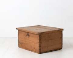 Swedish chest or box in pine. Never painted with smaller details in iron, such as the hinges which extends up the lid