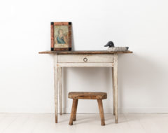 White gustavian desk from Sweden made during the late 18th century, around 1790 to 1800. The desk is pine with distressed white paint