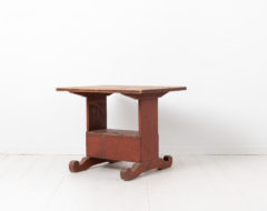 Country folk art table from the late 18th century. The table is pine with the original red paint as well as the authentic patina from the 18th century