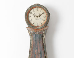 Swedish long case clock from the 1820s to 1840s. The clock has a rococo shape with the original blue green paint and case in pine