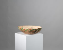Organically shaped wood bowl from Northern Sweden with traces of painted decor around the outside edge. The bowl has a genuine patina