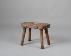 Folk art pine stool from northern Sweden. The stool is from the early 1800s and in untouched condition. Some distress along with a few dry cracks.