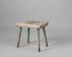 Northern Swedish antique stool with a square seat from the mid 1800s in untouched condition. The seat is organically worn