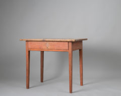 Northern Swedish gustavian table made during the late 1700s. The table has a single center drawer and straight legs with flutes.