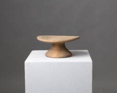 Folk art wooden stand with a round foot and a house mark underneath.The stand is northern Swedish and made around the early 1800s
