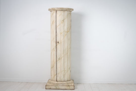 Gustavian column pedestal cabinet from the late 1700s made in painted pine. The cabinet is Swedish and a very unusual furniture.