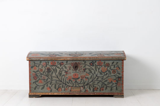 Folk art pine chest from Northern Sweden made during the early 1800s. The chest is very elaborately decorated with many coloured flowers on a blue base