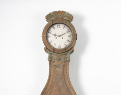 Rococo long case clock with a case in pine and dry scraped to the original first layer of paint. The clock is a so calledFryksdals clock