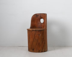 Swedish rustic Kubbstol from the turn of the century around 1900. Made in untreated pine which hasgained an authentic patina
