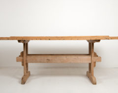 Country dining trestle table from Northern Sweden. The table is from the mid 19th century and made in pine with a solid table top .