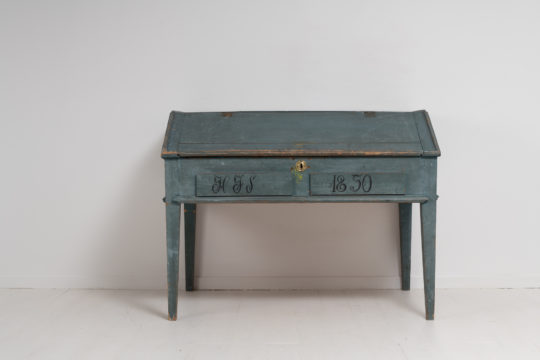 Swedish blue writing desk in painted pine. The table is in untouched original condition with the original blue toned paint. Dated 1850